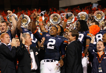 AUBURN, AL - NOVEMBER 13:  Quarterback Cameron Newton #2 of the Auburn Tigers celebrates with fans after their 49-31 win over the Georgia Bulldogs at Jordan-Hare Stadium on November 13, 2010 in Auburn, Alabama.  (Photo by Kevin C. Cox/Getty Images)
