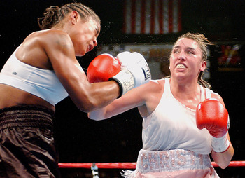 BILOXI, MS - AUGUST 23:  Laila Ali and Christy Martin square off  on August 23, 2003 at Mississippi Coast Coliseum in Biloxi, Mississippi. Ali defeated Martin with a 4th round knock out. (Photo by Chris Graythen/Getty Images)