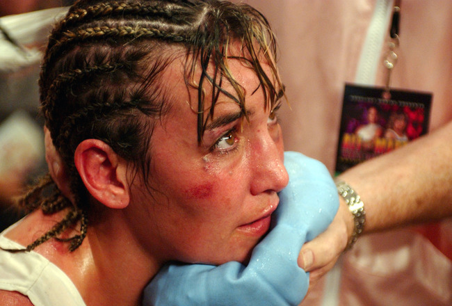 BILOXI, MS - AUGUST 23:  Christy Martin rests in her corner after being defeated by Laila Ali in the fourth round on August 23, 2003 at the Mississippi Coast Coliseum in Biloxi, Mississippi. (Photo by Chris Graythen/Getty Images)