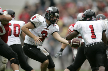 COLUMBUS, OH - SEPTEMBER 2:  Quaterback Phil Horvath #3 of the Northern Illinois University Huskies hands-off the ball to his running back Garrett Wolfe #1 during the game against the Ohio State University Buckeyes on September 2, 2006 at Ohio Stadium in