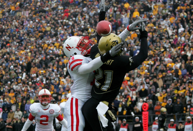 BOULDER, CO - NOVEMBER 23:  Cornerback Anthony Blue #14 of the Nebraska Cornhuskers breaks up a pass in the endzone intended for wide receiver Scotty McKnight #21 of the Colorado Buffaloes during Big 12 College Football action at Folsom Field on November