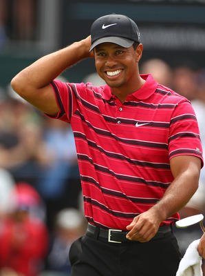 MELBOURNE, AUSTRALIA - NOVEMBER 14:  Tiger Woods of the USA acknowledges the crowd as he walks off the 18th hole during day four of the Australian Masters at The Victoria Golf Club on November 14, 2010 in Melbourne, Australia.  (Photo by Robert Cianflone/