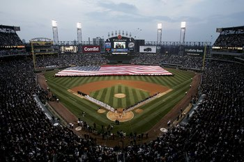 CHICAGO - APRIL 02:  A giant U.S. flag is unfurled during the National Anthem prior to the start of the Opening Day game between the Cleveland Indians and the Chicago White Sox on April 2, 2006 at U.S. Cellular Field in Chicago, Illinois.  (Photo by Peter