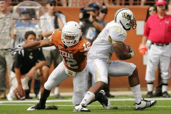 AUSTIN, TX - NOVEMBER 07:  Safety Earl Thomas #12 of the Texas Longhorns makes a tackle against the UCF Knights on November 7, 2009 at Darrell K Royal - Texas Memorial Stadium in Austin, Texas.  Texas won 35-3.  (Photo by Brian Bahr/Getty Images)
