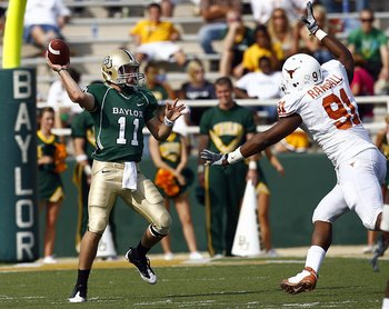 WACO, TX - NOVEMBER 14:  Quarterback Nick Florence #11 of the Baylor Bears looks for an open receiver as tackle Kheeston Randall #91 rushes in the second half on November 14, 2009 at Floyd Casey Stadium in Waco, Texas.  The Longhorns beat the Bears 47-14.