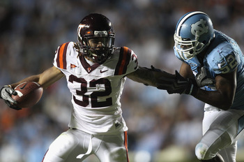 CHAPEL HILL, NC - NOVEMBER 13:  Darren Evans #32 of the Virginia Tech Hokies is tackled by Quan Sturdivant #52 of the North Carolina Tar Heels during their game at Kenan Stadium on November 13, 2010 in Chapel Hill, North Carolina.  (Photo by Streeter Leck