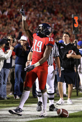 TUCSON, AZ - NOVEMBER 21:  Wide receiver William Wright #19 of the Arizona Wildcats celebrates after scoring a third quarter touchdown against the Oregon Ducks during the college football game at Arizona Stadium on November 21, 2009 in Tucson, Arizona.  (