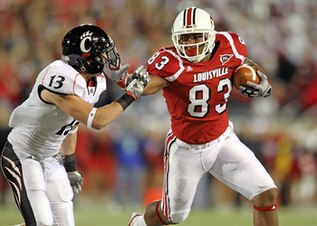LOUISVILLE, KY - OCTOBER 15:  Cameron Graham #83 of the Louisville Cardinals runs with the ball while defended by Cody Kater #13 of the Cincinnati Bearcats during the game at Papa John's Cardinal Stadium on October 15, 2010 in Louisville, Kentucky.  (Phot