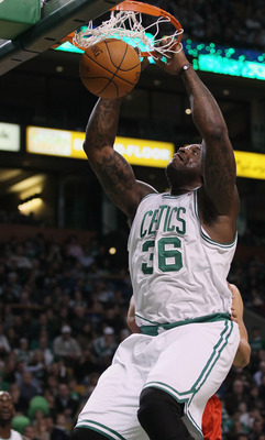 BOSTON - NOVEMBER 24:  Shaquille O'Neal #36 of the Boston Celtics dunks the ball in the first quarter against the New Jersey Nets on November 24, 2010 at the TD Garden in Boston, Massachusetts. NOTE TO USER: User expressly acknowledges and agrees that, by