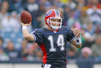 ORCHARD PARK, NY - NOVEMBER 14:  Ryan Fitzpatrick  #14 of the Buffalo Bills throws a pass against the Detroit Lions at Ralph Wilson Stadium on November 14, 2010 in Orchard Park, New York. The Bills won 14-12.  (Photo by Rick Stewart/Getty Images)