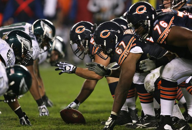 CHICAGO - NOVEMBER 22: Members of the Chicago Bear offense line up against the defense of the Philadelphia Eagles at Soldier Field on November 22, 2009 in Chicago, Illinois. The Eagles defeated the Bears 24-20. (Photo by Jonathan Daniel/Getty Images)
