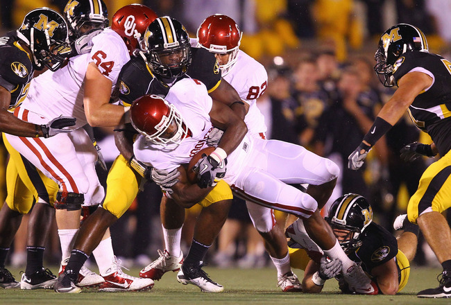 COLUMBIA, MO - OCTOBER 23: DeMarco Murray #7 of the Oklahoma Sooners is tackled by Jacquies Smith #3 of the Missouri Tigers at Faurot Field/Memorial Stadium on October 23, 2010 in Columbia, Missouri.  (Photo by Dilip Vishwanat/Getty Images)