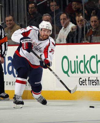 NEWARK, NJ - NOVEMBER 22:  Karl Alzner #27 of the Washington Capitals skates against the New Jersey Devils at the Prudential Center on November 22, 2010 in Newark, New Jersey. The Devils defeated the Capitals 5-0.  (Photo by Bruce Bennett/Getty Images)
