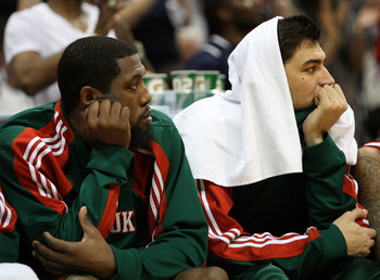ATLANTA - MAY 2:  Guard John Salmons #15 (L) and Forward Carlos Delfino #10 of the Milwaukee Bucks watch the closing minutes of Game Seven of the Eastern Conference Quarterfinals against the Atlanta Hawks during the 2010 NBA Playoffs at Philips Arena on M