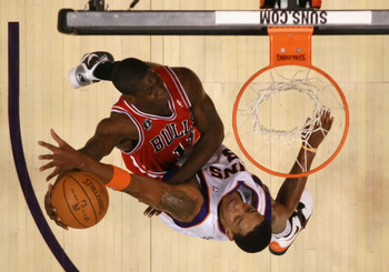 PHOENIX - NOVEMBER 24:  Ronnie Brewer #11 of the Chicago Bulls attempts a slam dunk over Channing Frye #8 of the Phoenix Suns during the NBA game at US Airways Center on November 24, 2010 in Phoenix, Arizona. The Bulls defeated the Suns 123-115 in double