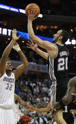CHARLOTTE, NC - NOVEMBER 08:  Manu Ginobili #20 of the San Antonio Spurs makes a basket late in the 4th quarter giving the Spurs a 95-91 victory over the Charlotte Bobcats during their game at Time Warner Cable Arena on November 8, 2010 in Charlotte, Nort