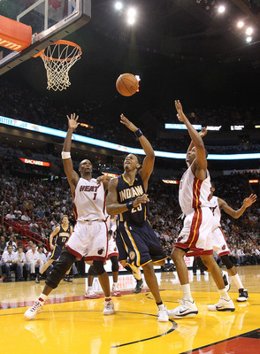 MIAMI - NOVEMBER 22:  Brandon Rush of the Indiana Pacers shoots over Chris Bosh #1 of the Miami Heat during a game at American Airlines Arena on November 22, 2010 in Miami, Florida. NOTE TO USER: User expressly acknowledges and agrees that, by downloading