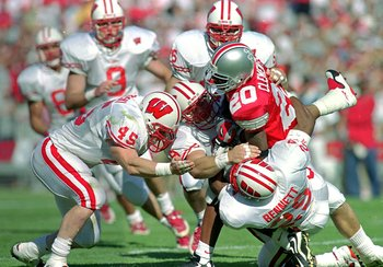 2 Oct 1999:  Nate Clements #20 of the Ohio State Buckeyes is tackled by Michael Bennett #29 of the Wisconsin Badgers at the Ohio Stadium in Columbus, Ohio. The Badgers defeated the Buckeyes 42-17. Mandatory Credit: Mark Lyons  /Allsport
