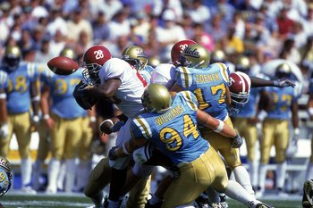 2 Sep 2000:  Shaun Bohanon #28 of the Alabama Crimson Tide has the ball knocked loose while Rusty Williams #94 and Jason Zdenek #17 of the UCLA Bruins try to tackle him at the Rose Bowl in Pasadena, California. The Bruins defeated the Crimson Tide 24-35.M