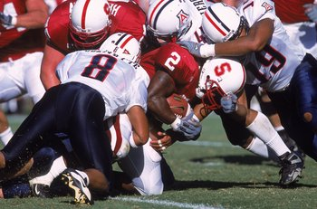 30 Sep 2000:  De Ronnie Pitts #2 of the Stanford Cardinals is tackled by Brandon Nash #19 and Michael Jolvivette #8 of the Arizona Wildcats during the game at Stanford Stadium in Palo Alto, California. The Wildcats defeated the Cardinals 27-3.Mandatory Cr