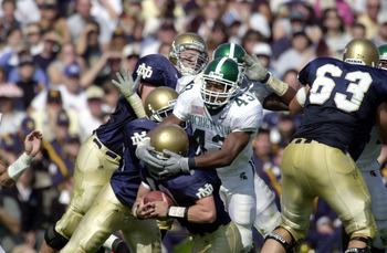 22 Sept 2001:  Safety Thomas Wright #43 of Michigan State sacks quarterback Matt LoVecchio #10 of Notre Dame in first half action at Notre Dame Stadium in South Bend, Indiana. DIGITAL IMAGE  Mandatory Credit: Jonathan Daniel/ALLSPORT