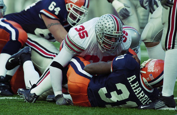CHAMPAIGN, IL - NOVEMBER 16:  Linebacker Matt Wilhelm #35 of the Ohio State University Buckeyes tackles Antoineo Harris #31 of the University of Illinois Fighting Illini during the Big Ten game at Memorial Stadium on November 16, 2002 in Champaign, Illino