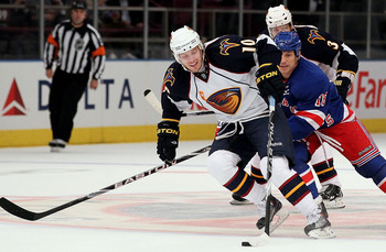 NEW YORK - OCTOBER 27:  Bryan Little #10 of the Atlanta Thrashers skates past Sean Avery #16 of the New York Rangers enroute to his first period goal on October 27, 2010 at Madison Square Garden in New York City.  (Photo by Jim McIsaac/Getty Images)