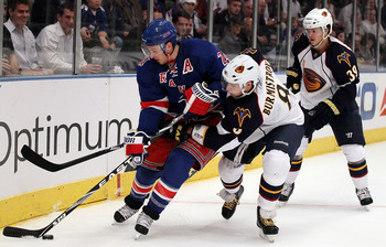 NEW YORK - OCTOBER 27:  Alexander Burmistrov #8 of the Atlanta Thrashers defends against Ryan Callahan #24 of the New York Rangers on October 27, 2010 at Madison Square Garden in New York City.  (Photo by Jim McIsaac/Getty Images)