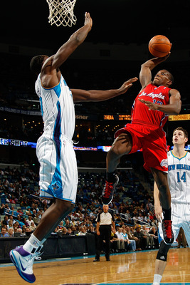 NEW ORLEANS - NOVEMBER 09:  Eric Bledsoe #12 of the Los Angeles Clippers shoots the ball over Emeka Okafor #50 of the New Orleans Hornets at the New Orleans Arena on November 9, 2010 in New Orleans, Louisiana. The Hornets defeated the Clippers 101-82.   N