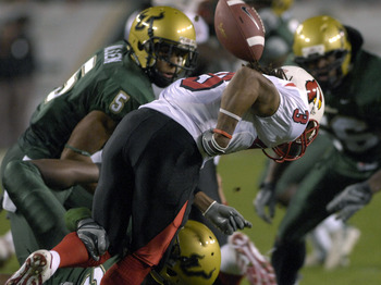 TAMPA, FL - NOVEMBER 17: Wide receiver Trent Guy #3 of the Louisville Cardinals fumbles the opening kickoff against the University of South Florida Bulls at Raymond James Stadium on November 17, 2007 in Tampa, Florida.  USF scored on the recovery and won