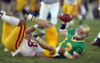 SOUTH BEND, IN - OCTOBER 20: Evan Sharpley #13 of the Notre Dame Fighting Irish is sacked by Rey Maualuga #58 of the University of Southern California Trojans at Notre Dame Stadium October 20, 2007 in South Bend, Indiana. USC defeated Notre Dame 38-0. (Ph