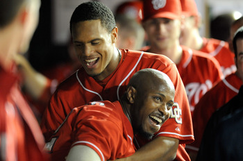 WASHINGTON - SEPTEMBER 24:  Willie Harris #22 of the Washington Nationals celebrates with Justin Maxwell #30 after hitting an inside the park home run in the seventh inning against the Atlanta Braves at Nationals Park on September 24, 2010 in Washington,