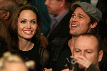 LAS VEGAS - DECEMBER 08:  Actors Angelina Jolie and Brad Pitt talk before the fight between Ricky Hatton of England and Floyd Mayweather Jr. prior to their WBC world welterweight championship fight at the MGM Grand Garden Arena on December 8, 2007 in Las