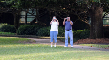 WINDERMERE, FL - NOVEMBER 30:   People take pictures from the gate of the Isleworth community, which is home to Tiger Woods, on November 30, 2009 in Windermere, Florida. Tiger Woods has not spoken with media or Florida Highway Patrol since he drove his SU