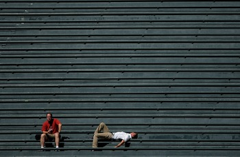 DENVER - SEPTEMBER 18:  Two fans in the vacant centerfield bleachers bask in the warm sun on a late summer afternoon as the Colorado Rockies host the Los Angeles Dodgers at Coors Field on September 18, 2007 in Denver, Colorado. The Rockies defeated the Do