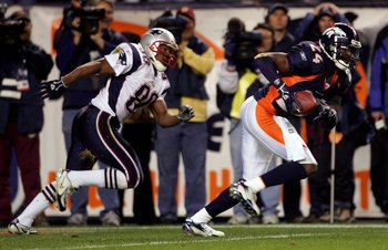 DENVER - JANUARY 14:  Cornerback Champ Bailey #24 of the Denver Broncos intercepts a pass in front of wide receiver Troy Brown #80 of the New England Patriots and returns it 100-yards before fumbling at the 1-yard yardline in the third quarter of the AFC