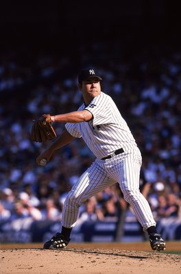 24 Jul 1999: Pitcher Hideki Irabu #14 of the New York Yankees winds back to throw the ball during a game against the Cleveland Indians at the Yankee Stadium in Bronx, New York. The Yankees defeated the Indians 21-1. Mandatory Credit: Ezra O. Shaw  /Allspo