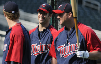 MINNEAPOLIS, MN - JUNE 28:   (L-R) Justin Morneau #33, Joe Mauer #7 and Jim Thome #25 of the Minnesota Twins talk during batting practice prior to their game against the Detroit Tigers on June 28, 2010 at Target Field in Minneapolis, Minnesota. Tigers won
