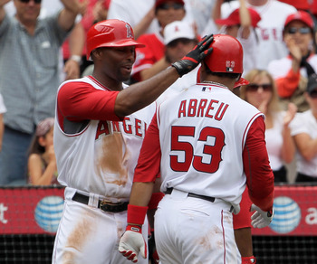 ANAHEIM, CA - MAY 16:  Bobby Abreu #53 of the Los Angeles Angels of Anaheim is congratulated by Torii Hunter #48 after hitting a two-run homerun in the sixth inning against the Oakland Athletics at Angel Stadium on May 16, 2010 in Anaheim, California. The