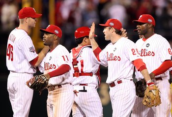 PHILADELPHIA - NOVEMBER 02:  (L-R) Ryan Madson #46 of the Philadelphia Phillies is congratulated by Jimmy Rollins #11, Chase Utley #26 and Ryan Howard #6 after their 8-6 win against the New York Yankees in Game Five of the 2009 MLB World Series at Citizen