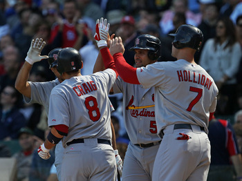 CHICAGO - SEPTEMBER 24: Allen Craig #8 of the St. Louis Cardinals is congratulated by (L-R) Pedro Feliz #77, Albert Pujols #5 and Matt Holliday #7 after hitting a three-run home run in the 1st inning against the Chicago Cubs at Wrigley Field on September