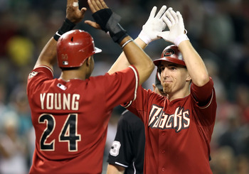 PHOENIX - AUGUST 18:  Adam LaRoche #25 of the Arizona Diamondbacks is congratulated by teammate Justin Upton #10 after LaRoche hit a 2 run home run against the Cincinnati Reds during the seventh inning of the Major League Baseball game at Chase Field on A