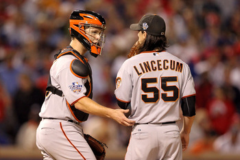 ARLINGTON, TX - NOVEMBER 01:  (L-R) Catcher Buster Posey #28 of the San Francisco Giants talks with Tim Lincecum #55 against the Texas Rangers in Game Five of the 2010 MLB World Series at Rangers Ballpark in Arlington on November 1, 2010 in Arlington, Tex