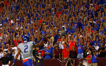 LANDOVER, MD - SEPTEMBER 06:  Boise State Broncos fans cheer after wide receiver Austin Pettis #2 scores a touchdown against the Virginia Tech Hokies at FedExField on September 6, 2010 in Landover, Maryland.  (Photo by Geoff Burke/Getty Images)