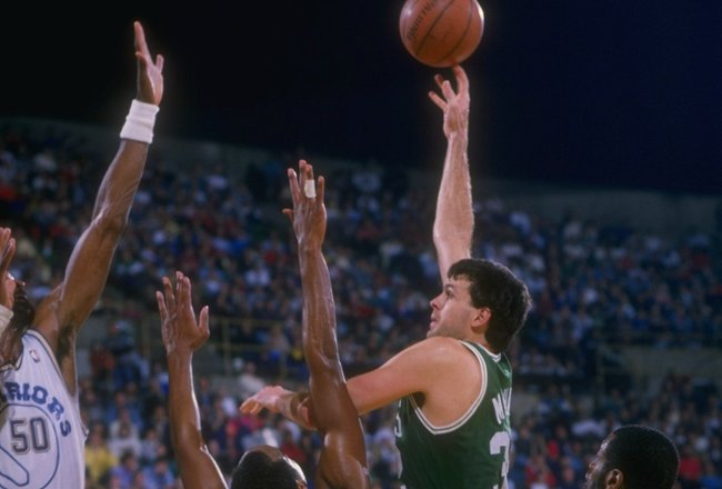 Forward Kevin McHale of the Boston Celtics shoots the ball during a game versus the Golden State Warriors at the Oakland Coliseum Arena .