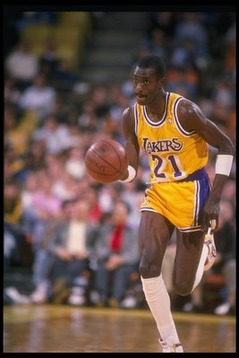 1988-1989:  Michael Cooper of the Los Angeles Lakers moves the ball during a game. Mandatory Credit: Mike Powell  /Allsport Mandatory Credit: Mike Powell  /Allsport