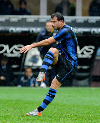 MILAN, ITALY - NOVEMBER 28:  Dejan Stankovic of FC Internazionale Milano scores the first goal during the Serie A match between Inter and Parma at Stadio Giuseppe Meazza on November 28, 2010 in Milan, Italy.  (Photo by Claudio Villa/Getty Images)