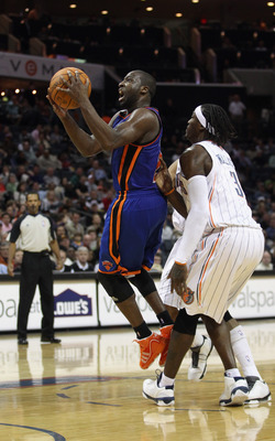 CHARLOTTE, NC - NOVEMBER 24:  Raymond Felton #2 of the New York Knicks drives past Gerald Wallace #3 of the Charlotte Bobcats during their game at Time Warner Cable Arena on November 24, 2010 in Charlotte, North Carolina.  NOTE TO USER: User expressly ack