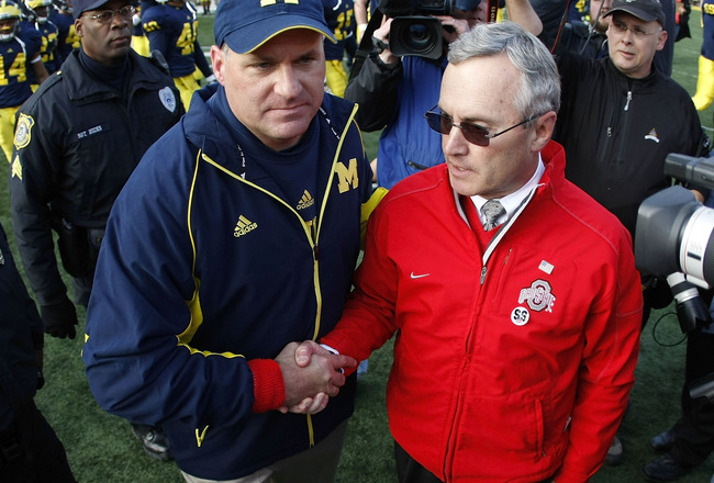 ANN ARBOR, MI - NOVEMBER 21: Head coach Jim Tressel of the Ohio State Buckeyes shakes hands after a 21-10 victory with head coach Rich Rodriguez of the Michigan Wolverines on November 21, 2009 at Michigan Stadium in Ann Arbor, Michigan.  (Photo by Gregory