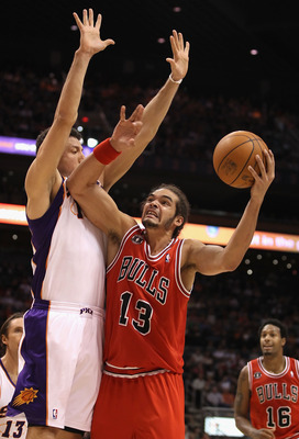 PHOENIX - NOVEMBER 24:  Joakim Noah #13 of the Chicago Bulls puts up a shot against the Phoenix Suns during the NBA game at US Airways Center on November 24, 2010 in Phoenix, Arizona. The Bulls defeated the Suns 123-115 in double overtime. NOTE TO USER: U